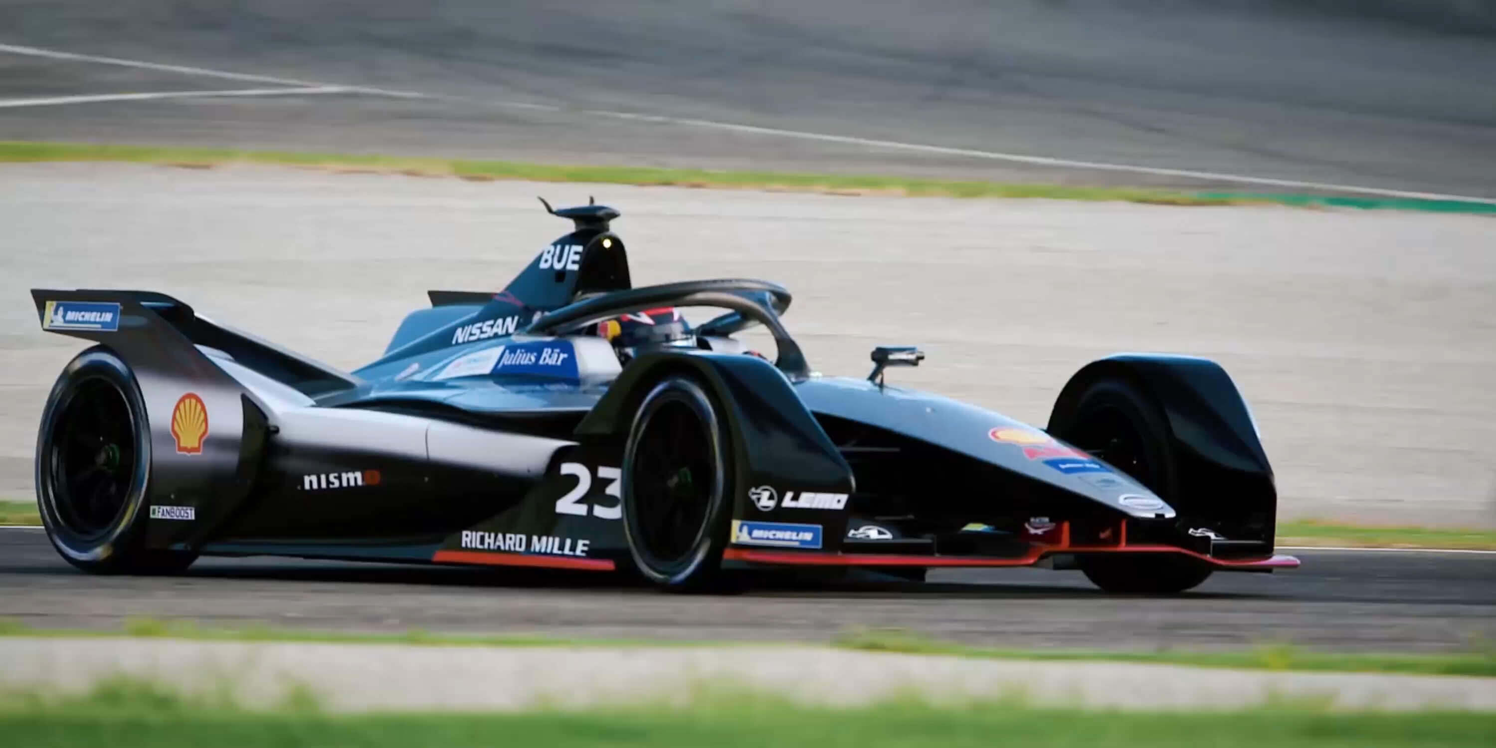 Nissan Formula E racer driving on track